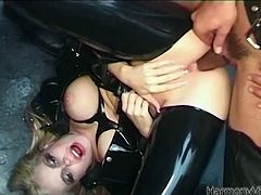 Devilish slut wearing leather costume is bent over and stuffed in her both fuck holes with fat sex toys. She then gets fucked hard in dirty gangbang fuck action.