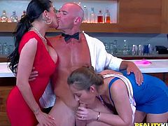 Dani Daniels and Romi Rain are sexy best friends in bright red and blue dresses. They turn guy on and then suck his rock hard cock together. They cant keep their lips off his love stick.