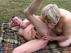 Watch two nasty lesbian grannies as they munch and finger their tight pink pussies in this awesome outdoor sex video. Their age has only made them hornier!
