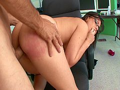 An absolutely stunning brunette secretary calls her boyfriend from her desk, and he tells her that he is really horny. She describes what she is wearing to turn him on, but we get the real show. Her tits are huge, and she is beautiful, even with her nerdy glasses on and her hair pulled back. She begins to masturbate in her chair as they talk, but her boss catches her. Not wanting to waste her flowing pussy juices, he gets naked too and they fuck like animals on the floor. Her tits are absolutely perfect!