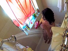 Brunette whore Mia Hurley is shaving pussy and taking a shower