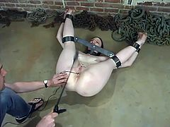 This submissive girl stands on all fours being tied up. She gets her ass spanked and tits tortured. Later on she also gets whipped with a stick.