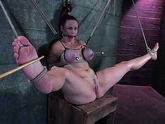 Well-endowed hottie Bella Rossi allows some man bind and hang her up in a basement. The dude tortures the cutie and then fucks her awesome vag with a dildo.