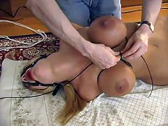 Curvaceous blonde girl gets tied up and gagged. After that she gets her vagina toyed with a vibrator and a dildo.