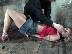 Mean man is giving this slutty blond sex slave Kylie Wilde some extraordinary pain! He suspends her in a hogtied and gags her mouth with a ball.