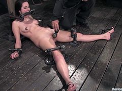 Hot brown-haired chick Winter Sky is having a good time with some dude in a cellar. She lets him shackle her and then gets pulled by the nipples and enjoys some naughty toying.