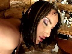 Valentina Velasquez and Andy Brown are two gorgeous brunette chicks in bikini and high heels. These beauties lick and toy each others pussies near the bar counter.