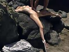 Slim blonde girl gets tied up by some guy on a beach. Later on she gets her ass whipped and spanked painfully.