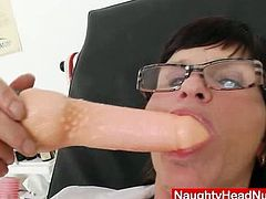 Nasty mature slut in nurse uniform is alone with lot of sex toys and she is ready to rub her cunt and makes it slimy and wet for one big dildo.