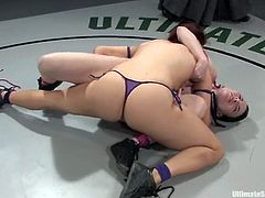 Two sexy chicks in bikini fight in a ring. They rip their bikini in a heat of a battle and then have hot lesbian sex.