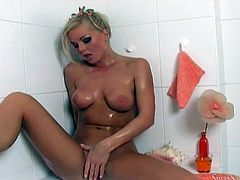 Gorgeous Silvia Saint takes a bath. She also fondles her nice boobs and shaved pussy. Then she stands up and pours water on her nice ass.