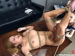 Slutty blonde chick Jenni Lee is having a good time with her lesbian GF. She lets the mistress tie her up and attach forceps to her tits and then gets her twat pounded with a dildo.