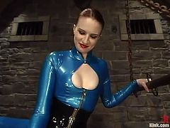 Kinky dominatrix Claire Adams is having a good time with submissive stud Sterling Ward. She binds him and jumps on his chest and then plays with his shaft and beats him with a stick.
