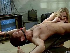 What she does is she bondages this poor man and then twitches his nipples with wires, giving him a tight bondage in his cock as well!
