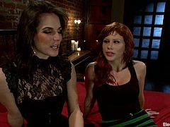 There's some pretty kinky stuff going on in this lesbian femdom video where Bobbi Starr plays with some devices on Brooklyn Lee.