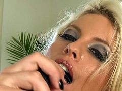 Blonde milf playing naughty in solo