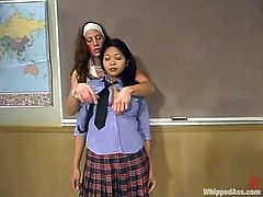 Mika Tan gets whipped and whipped by Kym Wilde in the classroom. Later on she also gets pinched with claws and toyed with a strap-on.