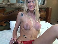 This sexy blonde transsexual pulls her red panties off, so you can get a good look and her long cock, then she gets to work, stroking herself off. Watch as she tugs on her lady dick, until she explodes.