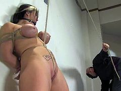 Busty milf Claire Dames lets Sgt. Major tie her up in a gym and play with her body. Major pulls Claire by the nipples and then fucks her vag with a dildo.