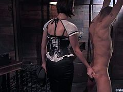 Nasty Bobbi Starr ties the guy up. Then she pours hot wax on his back and whips the ass painfully. Later on she also tortures his dick.