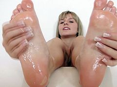 Hi there boys and girls! Do you like feet as much as I do? Then why not look at mine and how I play with them. My feet are gorgeous and when I oil them up you know I'm about to get naughty. See how they slide on this big, black dildo? Just imagine what I can do with a real hard cock! See the rest and enjoy it!