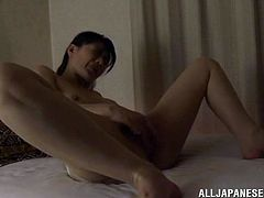 Charming Japanese chick Eriko Miura is getting naughty in her room. She strokes her nice body passionately and then finger-fucks her juicy pussy.