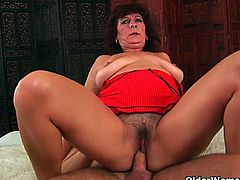 Busty and senior Alma from OlderWomanFun.com massages her large breasts and rubs her hairy pussy before she is joined bu young hard cock for her hairy pussy.Watch her getting her hairy pussy fucked hard and deep.