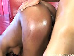 Watch this sexy booty ebony babe getting her big booty oiled up as she wiggles it.She bends over and shows her tight pussy while shaking that thick booty of her's on the red leather couch.She is really horny and gets her tight black wet pussy rammed hard.