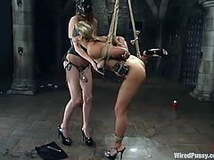 Toys, some kinky electrical torture devices and more stuff are used in this lesbian BDSM session by the dominant vixen.