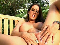 Superb Capri Cavanni shows off her gorgeous tits while finger fucking her cunt in outdoor