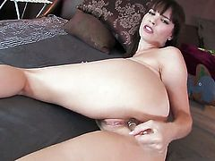 Dana DeArmond plays with her dripping wet beaver after stripping