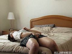 Charming Japanese girl Yuu Kawakami is getting naughty in her room. She moves her legs wide apart and rubs her pussy till getting an orgasm.