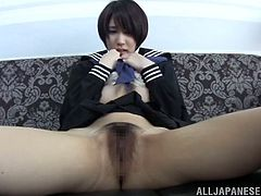 Slim Japanese girl in school uniform lifts the skirt up and fondles her bushy pussy. Later on she gives a blowjob and a rimjob to some dude.