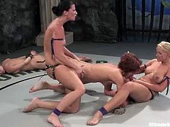 Ariel X, Harmony, Kylie Worthy and Sara Faye struggle with each other on tatami and get horny. They rub one another's hot nude bodies and then fuck their snatches with strapons.