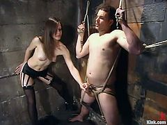 He is nailed on the wall and Bobbi Starr will take him out of it. But sure not to let him go! She traps him in another bondage and starts humiliating him!