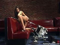 Sexy brunette with big boobs and nice ass strips her clothes off in some bar. Then she gets toyed by different fucking machines.