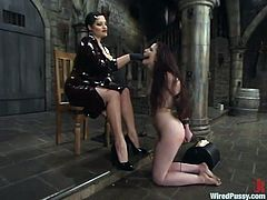 Betka Schpitz is playing dirty games with Caroline Pierce in a cellar. Carol binds Betka, whips and humiliates her and then rubs her vag with a dildo to orgasm.