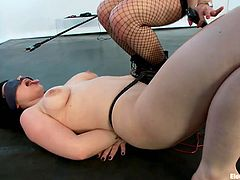 Blonde milf Lorelei has her ways with girls and electricity. This time is Bella's turn to experience a shocking touch of our hot mistress. Lorelei started with some humiliation and then inserted an electric sex toy in Bella's pussy. Bella is down on the floor, just like her dignity!