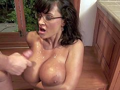 Tempting always horny wild cougar Lisa Ann with sexy glasses fucks with muscled Evan Stone all over the kitchen and makes him cum on her huge jaw dropping gazongas.