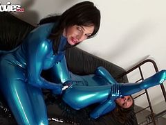 Lesbian couple in blue latex suits play with big vibrator