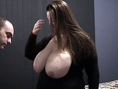 Brown-haired mom shows her enormous natural boobs to some guy and lets him play with her snatch. Then she stands on all fours and gets her cunt stunningly pounded doggy style.