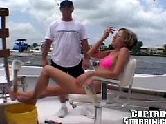 A fuckin' slutty bitch is about to get her fuckin' gash stuffed with hard dick on some dude's fuckin' yacht, check it out right here!