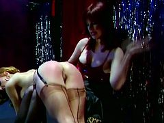 Two busty broads finished their day at work, and they wanted to have some fun so they did some spanking to each other in order to make their asses red