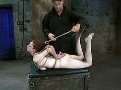 Redhead Iona Grace gets her tits overtwisted with ropes. After that she gets toyed with a vibrator by Isis Love.