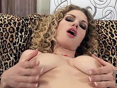 Bosomy blonde takes off her bra and plays with her juicy assets
