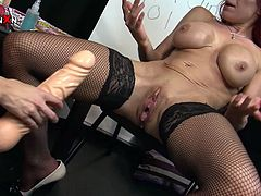This young bitch is so fucking horny! She stretches her lesbian friend's pussy with a huge dildo to get it ready for hot fisting session.