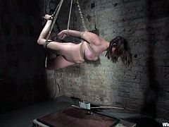 The tied up girl Sara Scott is going to be face sit and toyed by her dominatrix who plays with her using ropes and kink.