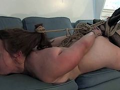 Slutty mom Mina Meow lets some guy tie her up in the living room. She lies on a sofa with ropes all over her body and enjoys being beaten.
