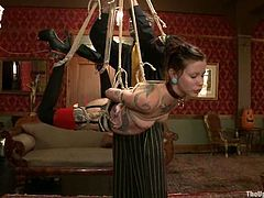 Krysta Kaos and Lilla Katt toy each others pussies lying on the floor to please their master. After that they get tied up and hanged up above the floor.