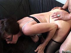 At first, she gets her hairy twat banged atop and then she gets fucked rough doggystyle on the couch. Look at this mature in Fame Digital xxx video!
